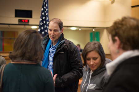 Ron Wyden, Democratic US Senator for Oregon talking to a constituent after his Washington County town hall.