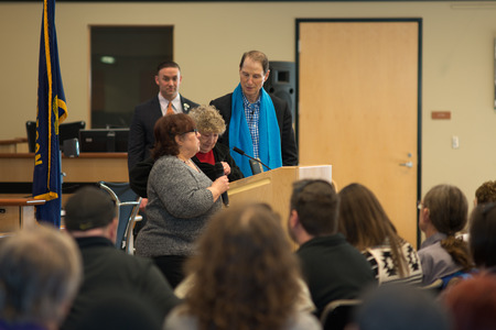 Ron Wyden, Democratic US Senator for Oregon at his Washington County town hall. Standing with family of a  World War II soldier killed in action that he presented with the purple heart. Editorial