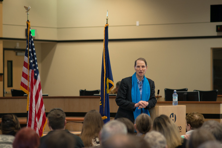 Ron Wyden, Democratic US Senator for Oregon talking at the podium at his Washington County town hall.