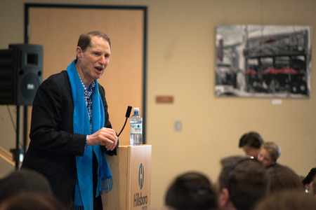 Ron Wyden, Democratic US Senator for Oregon talking passionately at the podium at his Washington County town hall.