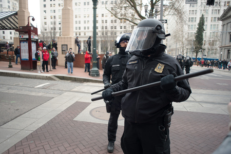 PORTLAND, OREGON JANUARY 25 2017, A police officer in riot gear after clearing the roadway of protesters of the police reaction to inauguration day protests who were blocking traffic.