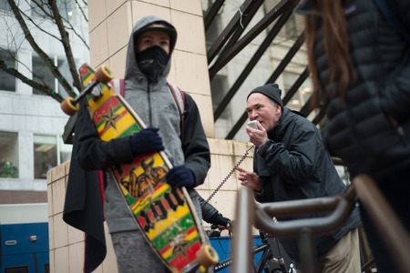 PORTLAND, OREGON JANUARY 25 2017, protester of the police reaction to inauguration day protests, speaking into a microphone.