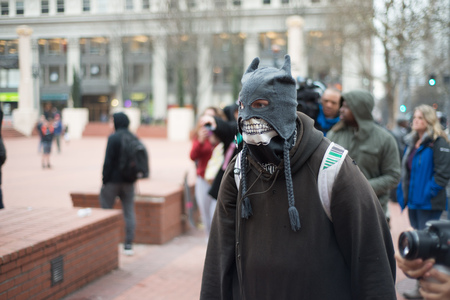 PORTLAND, OREGON JANUARY 25 2017, Protester of the police reaction to inauguration day protests, wearing mask in Pioneer Square. Stock Photo - 78040285