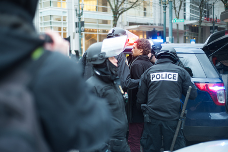 PORTLAND, OREGON JANUARY 25 2017, A man getting arrested during protests of the police reaction to inauguration day protests.