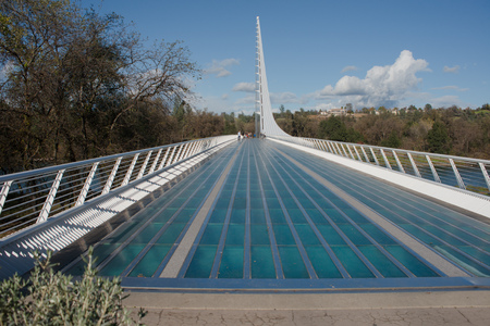REDDING, CALIFORNIA NOVEMBER 21 2016, The Sundial pedestrian bridge Sacramento River on a sunny fall day