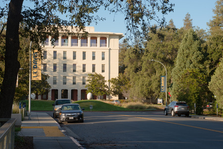 DAVIS CALIFORNIA, NOVEMBER 23 2016,  Looking down the street looking towards Mrak Hall, framed by trees, on the University of California, Davis campus. Stock Photo - 78214802