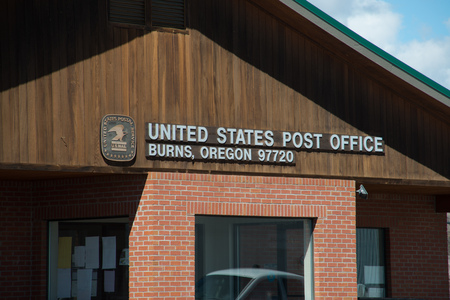 BURNS, OREGON APRIL 21 2016, Main signage on the Post Office in Burns.