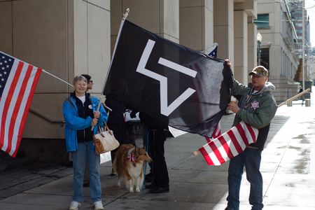 PORTLAND, OREGON MARCH 06 2017, a couple in front of the US District Court holding a flag protesting the second trial of participants of the occupation of the Malheur Wildlife Refuge and the death of LaVoy Finicum.