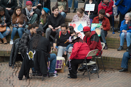 PORTLAND, OREGON MARCH 10 2017, A drum circle at a Protest of the Dakota Access Pipeline (DAPL) in the downtown Terry Shrunk Plaza park. Stock Photo - 79365974