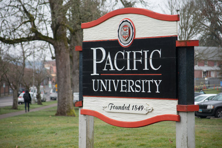 FOREST GROVE, OREGON MARCH 2 2017, Close up of a wooden entrance sign for Pacific Univesity. Editorial