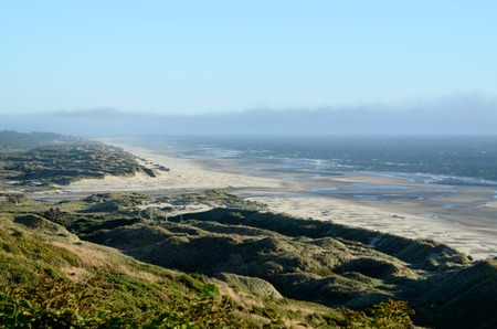 View of a long beach, dunes and coastline looking south towards Florence on the Oregon Central coast