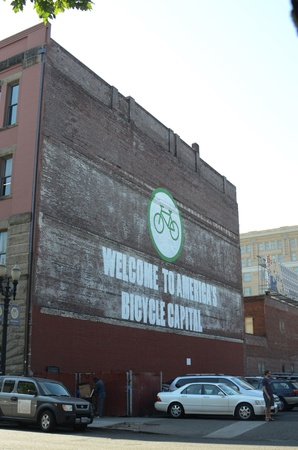 PORTLAND, OREGON CIRCA 2012, A mural on a building with iconography of a bicycle, text reading Welcome to Americas Bicycle Capitol