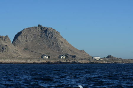 View of the Southeast Farallon Island, with the houses where scientific researchers live, as well as another building, and the Lighthouse on Tower Hill Editorial