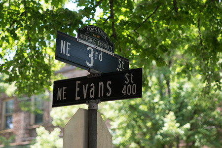 MCMINNVILLE, OREGON JUNE 6TH 2017, A sign marking the intersection of NE 3rd Street and NE Evans in the Downtown Historic District of town.