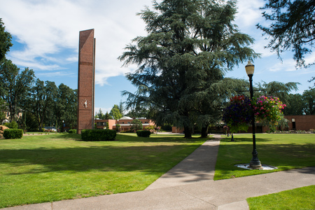 NEWBERG OREGON, AUGUST 15 2017, On the George Fox University campus, with the Centennial Tower in view, amongst a large grass lawn. Stock Photo - 84602372