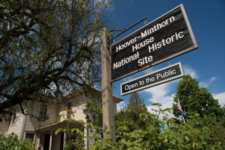 NEWBERG OREGON, AUGUST 15 2017, Sign for the  Hoover-Minthorn house, visible in the background. Home to 31st President Herbert Hoover as a child, and the oldest house in Newberg. Stock Photo - 84695035