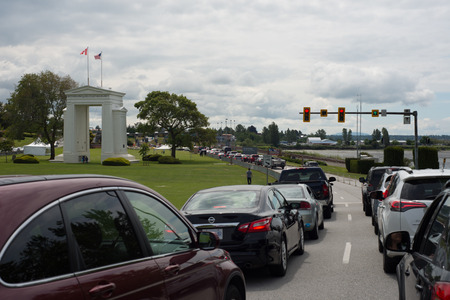 SURREY, BRITISH COLUMBIA, JUNE 10 2017, Cars waiting to advance at the Peace Arch Border Crossing between Blaine, Washington and Surrey, British Columbia on the border between United States and Canada Stock Photo - 89801847