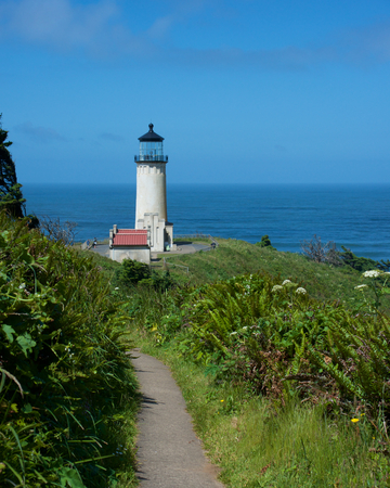 The North Head Lighthouse at Cape Disappointment in Washington. A walking path to the Lighthouse in the foreground.