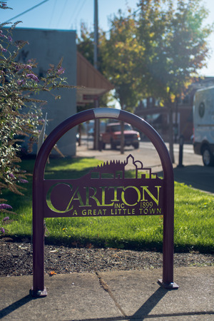 OCTOBER 10 2017, CARLTON, OREGON,  A bike rack with the towns slogan A Great Little Town  in the metalwork along Main Street. Editorial
