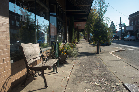 OCTOBER 10 2017, CARLTON, OREGON,  Looking down Main Street in the small town, with a couple resturant signs visable along the sidewalk.