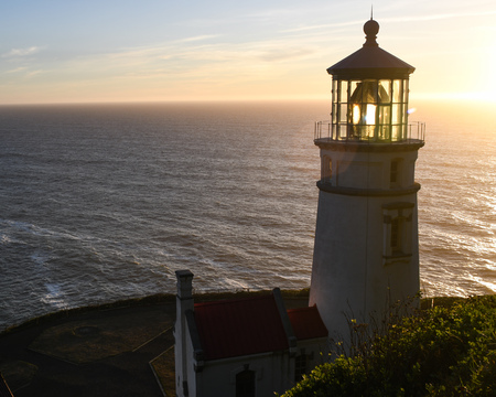 Heceta Head lighthouse between Florence and Yachats on the central Oregon coast at sunset.