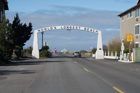 LONG BEACH, WASHINGTON OCTOBER 16 2017, a roadway to the beach, with an arch over it reading : Worlds longest beach.