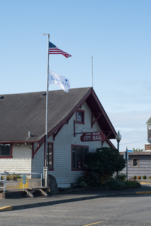 LONG BEACH, WASHINGTON OCTOBER 16 2017, The towns City Hall building, wint an american flag flying. Editorial