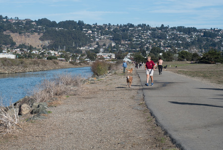 RICHMOND, CALIFORNIA, NOVEMBER 11 2017, People and their dogs at Point Isabel Dog Park, a off leash public dog park with views of the San Francisco Bay