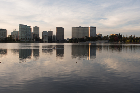 OAKLAND, CALIFORNIA, NOVEMBER 21 2018: A person rowing a kayak in Lake Merritt near dusk.