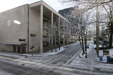 PORTLAND, OREGON, FEBRUARY 21 2018: Keller Auditorium and an icy intersection on the morning after snowfall.