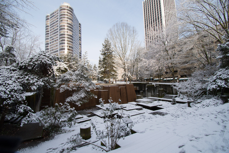 Keller Fountan park in Portland, Oregon covered in snow, with footprints throughout.