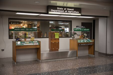 HONOLULU, HAWAII, FEBRUARY 21 2017: A display of prohibited items at the Department of Agriculture inspection station at the Daniel K. Inouye International Airport on the island of O'ahu