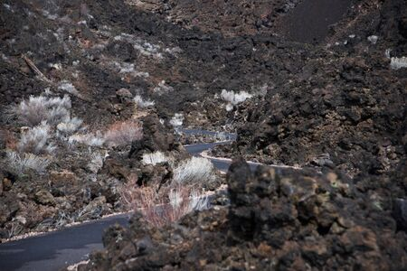 The Trail of the Molten Land pathway carved into the basalt lava flow in the Newberry National Volcanic Monument near Bend in central Oregon