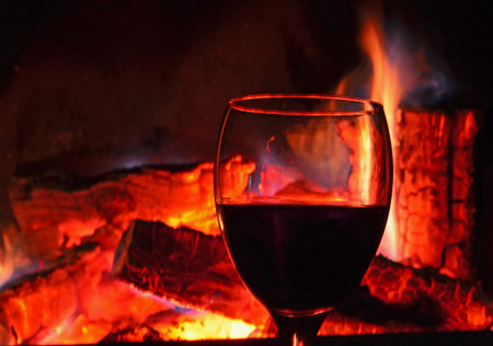 Red wine against the embers Stock Photo