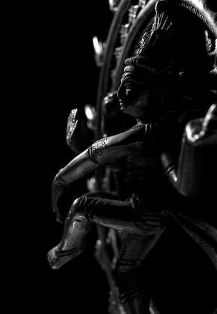 Shiva, a hindu god, on black background photo