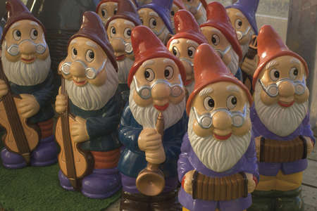 garden gnome: set of garden gnomes playing musical instruments for sale in garden centre