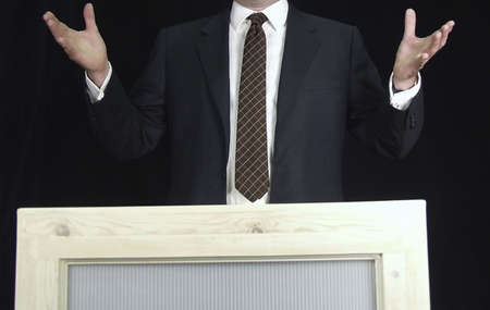 chief executive officers: man addressing crowd on podium with expressive hands