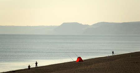 dorset: england dorset coast chesil beach fishermen
