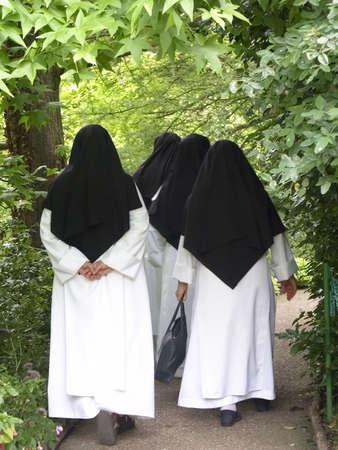 nuns: nuns walking through monets garden giverny normandy france Stock Photo