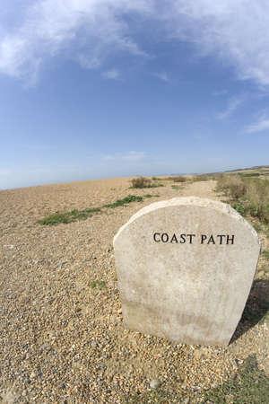 shingle beach: coast path sign shingle beach