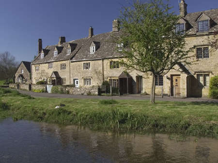 timbering: cottages by river Stock Photo