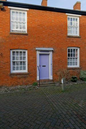brick house street front door Stock Photo