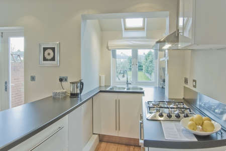 kitchen in newly restored rebuilt house  Stock Photo