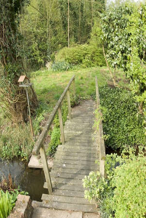bridge over stream in cottage garden photo