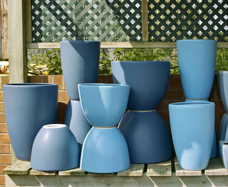 stacked up: blue pots stacked up in garden centre ready for sale Stock Photo