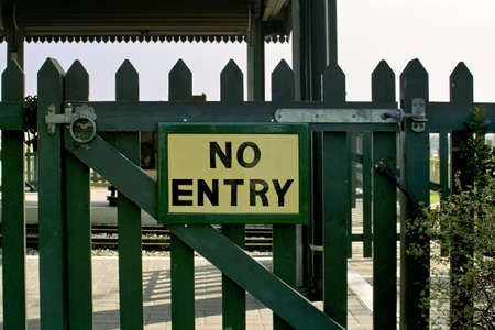 exclude: no entry sign on locked wooden gate