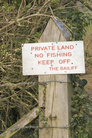 private land no fishing keep off the bailiff sign