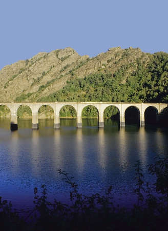 viaduct: railway viaduct lac de villefort cevennes languedoc-roussillon, lozere, southern france europe Stock Photo