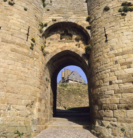 walled: dinan brittany entrance to old walled town through stone fortress gateway