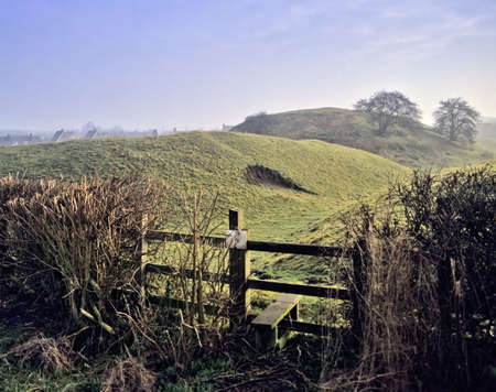 stile: motte and bailey castle yelden bedfordshire home counties england uk europe stile three shires way footpath